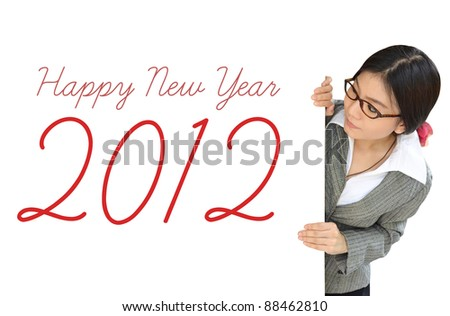 Young woman peeping over billboard with new year letter - stock photo