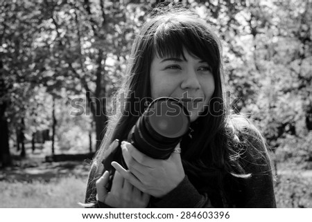 Young woman photographer. - stock photo