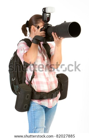 young woman photographer at work - stock photo