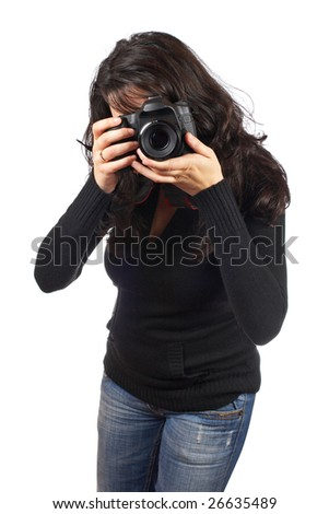 Young woman photographer holding a photo camera, isolated over white background