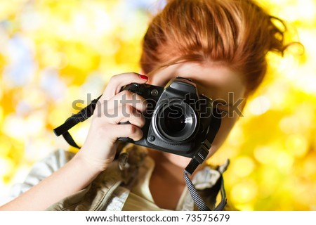 Young woman photographer outdoors portrait. - stock photo