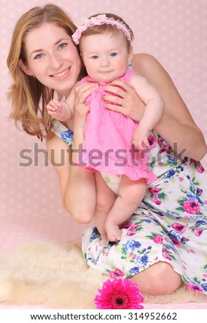 Young woman play with her daughter  - stock photo