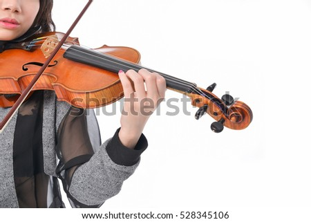 Young woman playing a violin isolated on white background