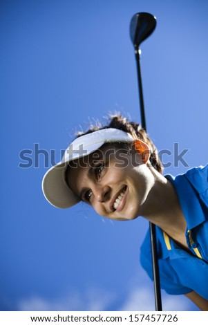 Young woman playing golf  - stock photo