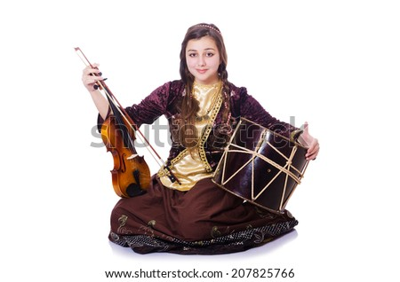 Young woman playing musical instruments on white - stock photo