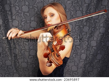 Young woman playing on violin