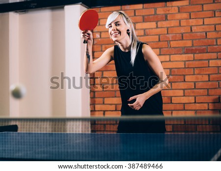 Young woman playing table tennis ping pong - stock photo