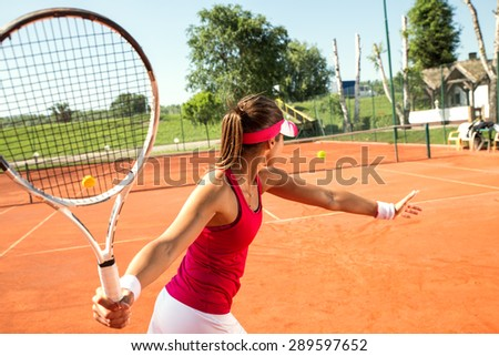 Young woman playing tennis.Forehand .