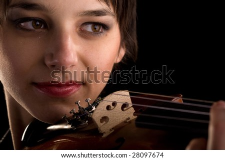 young woman playing the violin closeup