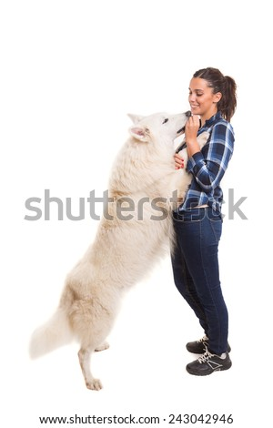 Young woman playing with her dog at the studio - stock photo