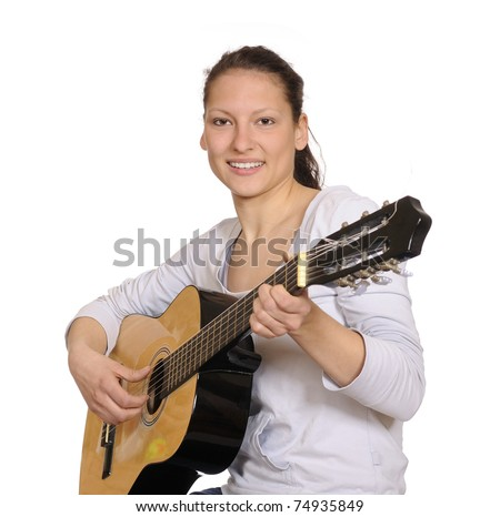 young woman plays guitar - stock photo