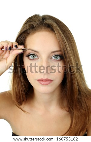 Young woman plucking eyebrows isolated on white - stock photo