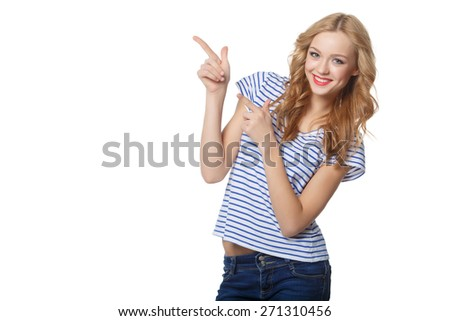 Young woman pointing at blank copy space, isolated over white - stock photo