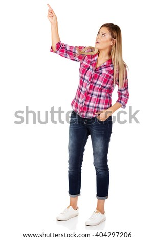 Young woman pointing at something  - stock photo