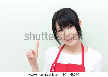 young woman pointing copy space - stock photo