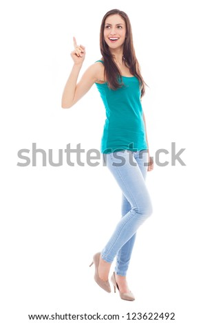 Young woman pointing up - stock photo