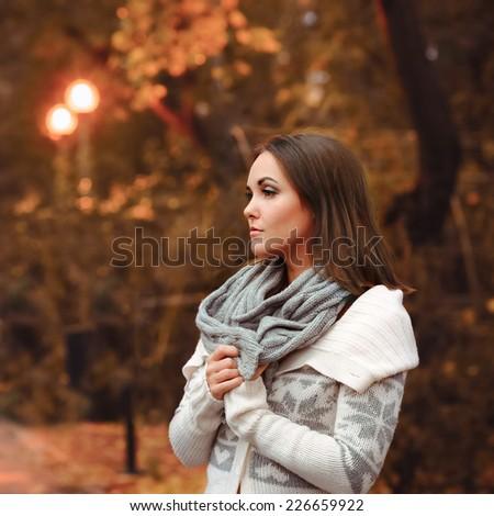 Young woman portrait autumn evening park. - stock photo