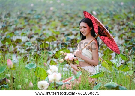 Young woman portraitbeautiful woman holding flower stock photo young woman portraitbeautiful woman holding flower with red umbrella on lotus flower background mightylinksfo