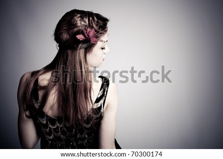young woman portrait from back, profile, studio shot - stock photo