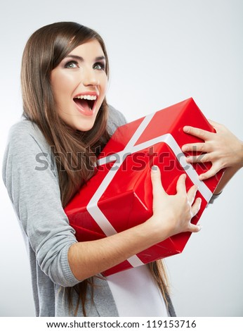 Young woman portrait hold gift in christmas color style . Smiling happy girl on white background. - stock photo