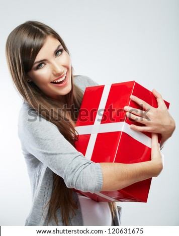 Young woman portrait hold gift in christmas color style . Smiling happy girl on white background.