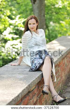 Young woman portrait in the park