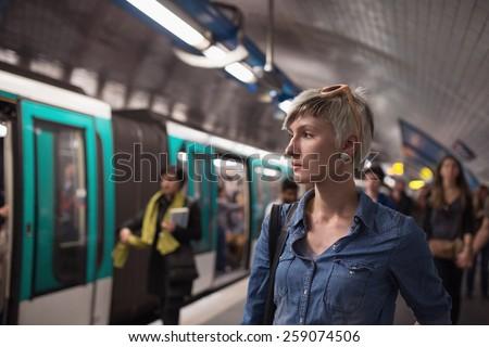 Young woman portrait inside metro subway. Paris, France. - stock photo