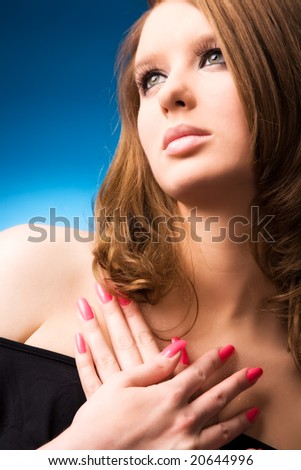 Young woman portrait. On blue background. - stock photo