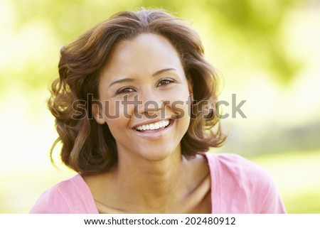 Young  woman portrait outdoors - stock photo