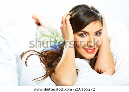 Young woman portrait resting in bed. Beautiful face girl. - stock photo
