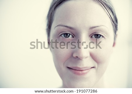 Young woman portrait. Soft yellow tint. - stock photo