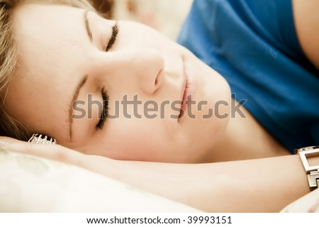 Young woman portrait still in bed. - stock photo
