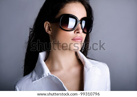 young woman portrait with big fashion sunglasses, studio shot - stock photo