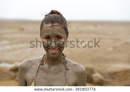 Young woman portrait with mud,Dead Sea,Israel - stock photo