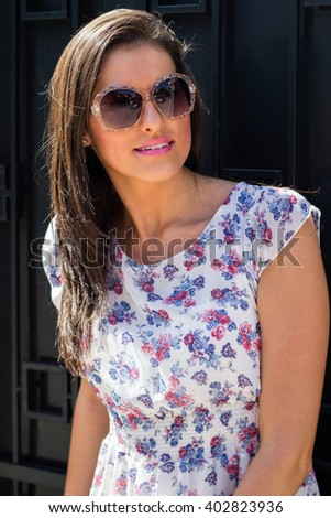 Young woman portrait with sunglasses - stock photo