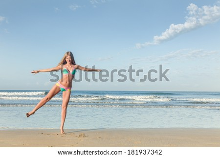 Young woman posing at tropical sea beach - stock photo