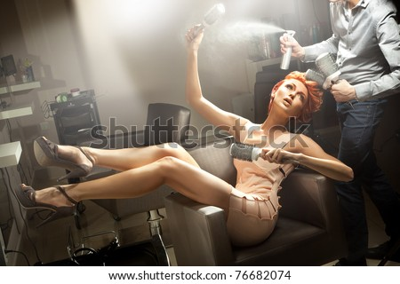 Young woman posing in hairdresser room - stock photo