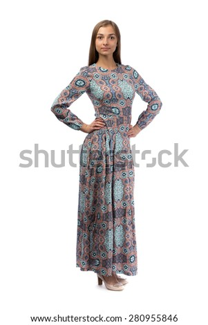 Young woman posing in long dress isolated on white. - stock photo
