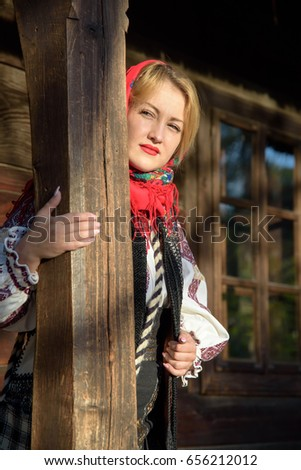 Young woman posing in romanian traditional costume