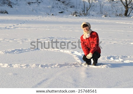 Young woman posing in winter and smiling - stock photo