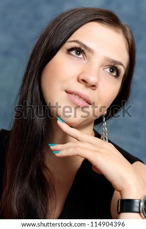 young woman posing on a blue background - stock photo