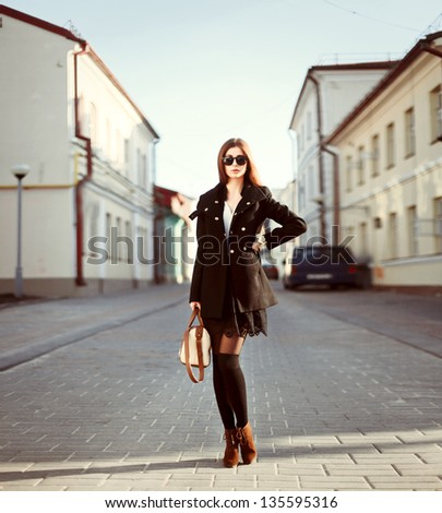 Young woman posing on the street. Outdoor spring fashion vintage portrait