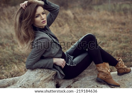 Young woman posing outdoor, autumn scenery - stock photo