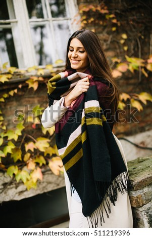 Young woman posing outside in autumn day