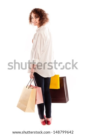 Young woman posing with shopping bags, isolated on white background - stock photo