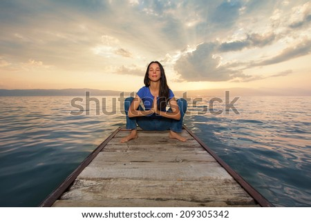 Young woman practicing yoga. - stock photo