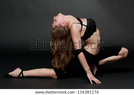 Young woman practicing Yoga exercises. Yoga and fitness.