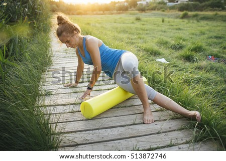 Young woman practicing yoga in a natural background.