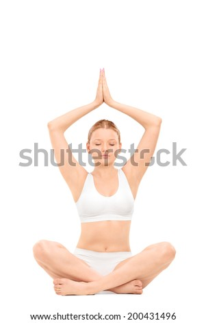 Young woman practicing yoga isolated on white background