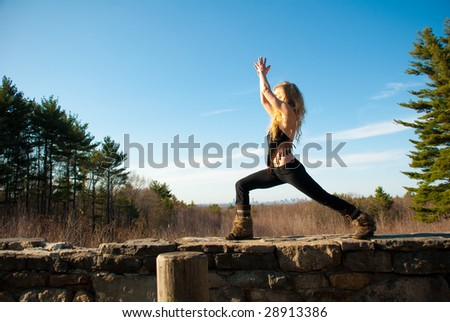 Young woman practicing yoga on a spring afternoon.